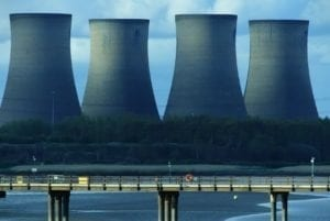 Four chimneys to signify pollution for post on Women and Climate Change Workshop