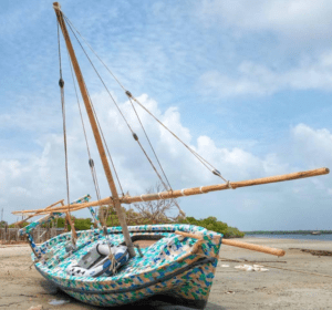 Dhow boat made completed from recycled plastic by the FlipFlopi Project on a beach