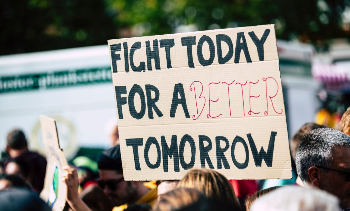 """Protest sign showing the message """"Fight Today for a Better Tomorrow"""""""
